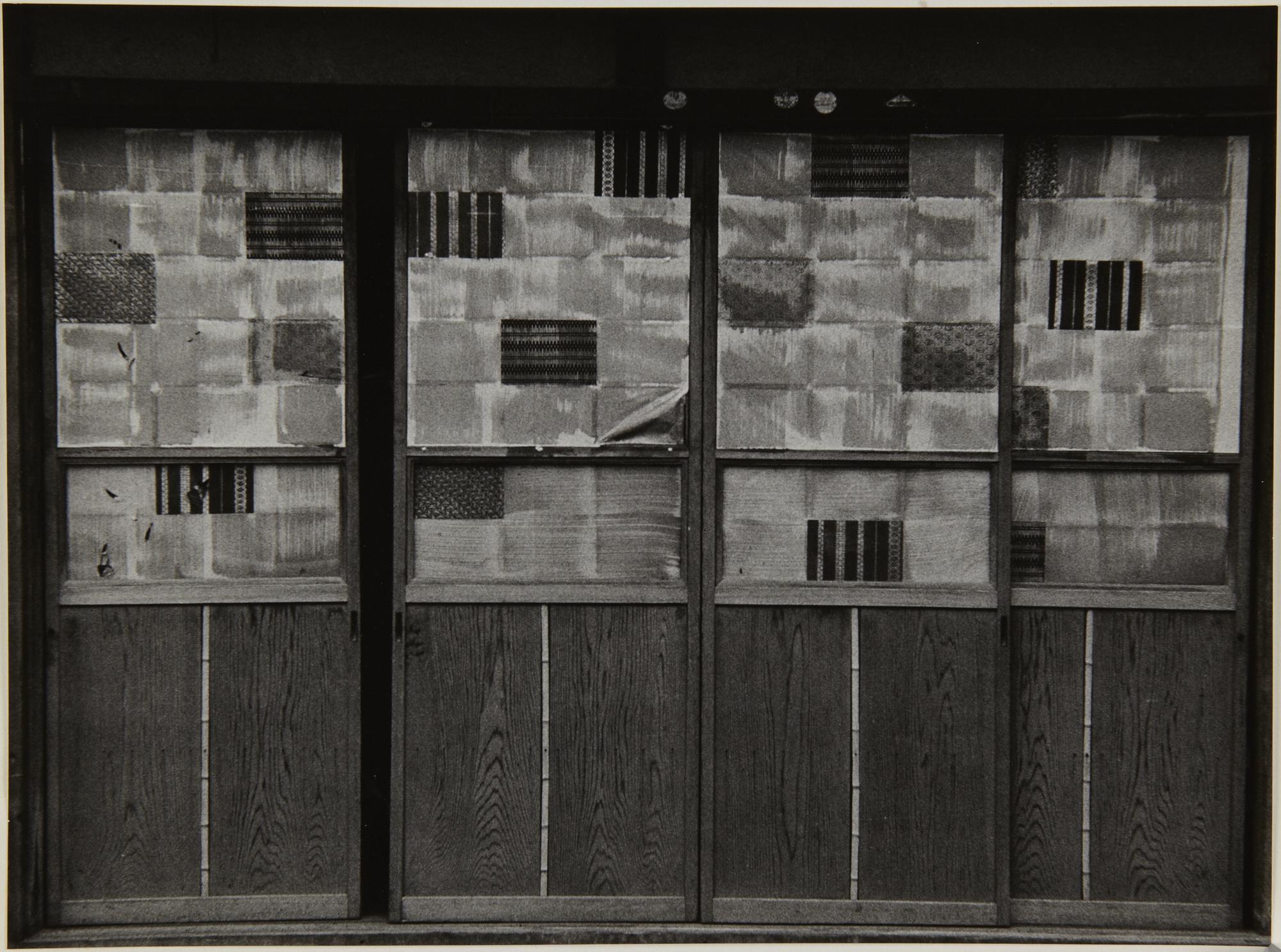 Kenji Ishiguro 石黒 健治. Sliding doors in Asakusa. 1958. Gelatin silver print.