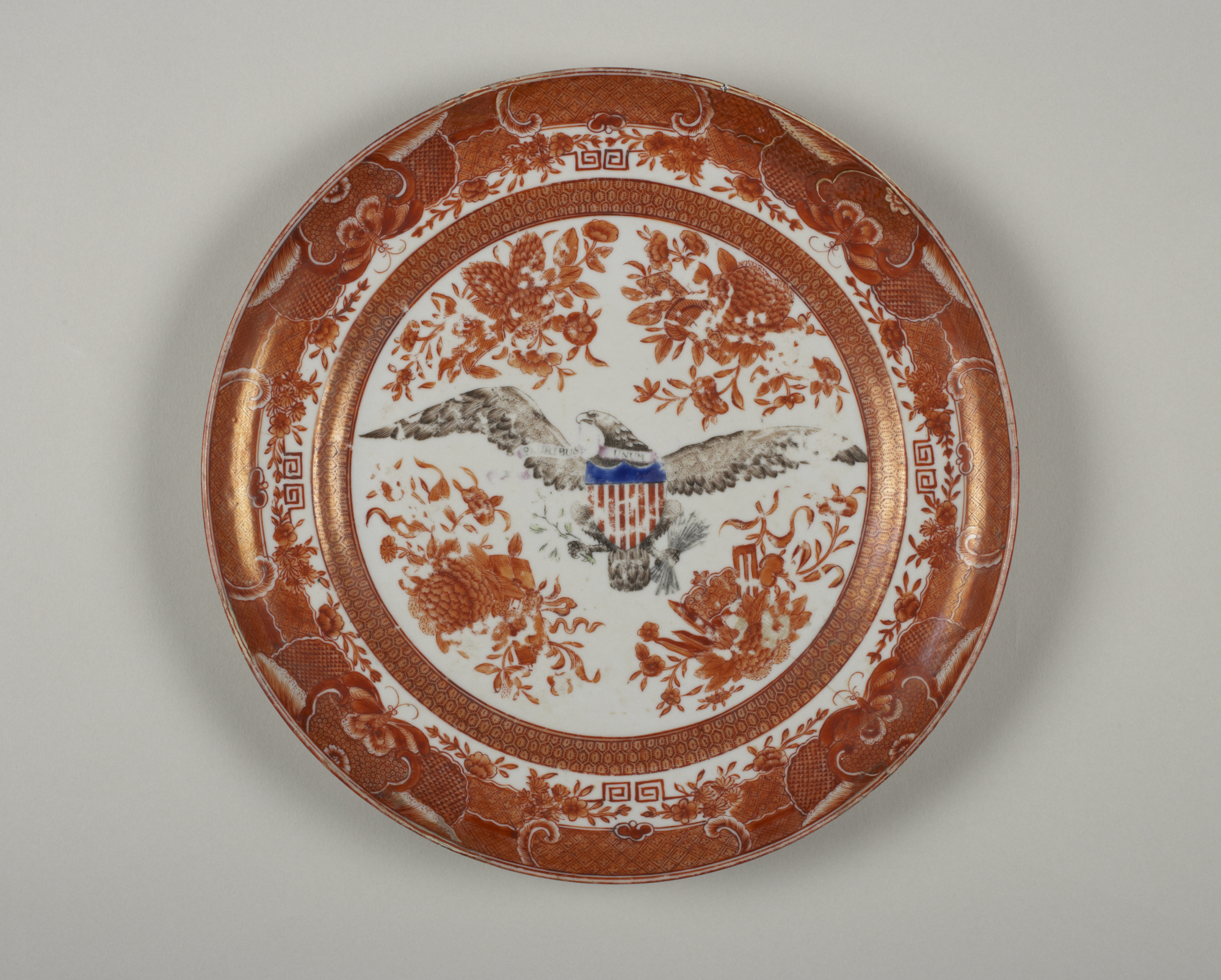 Chinese, Qing dynasty, 1644–1912: American Eagle plate, ca. 1790. Porcelain with overglaze enamels, h. 2.4 cm., diam. 24.7 cm. Gift of Clement K. Corbin, Class of 1902 (y1965-281).